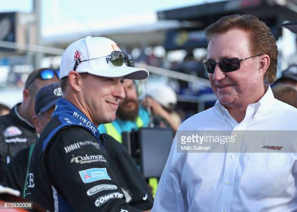 Daniel Hemric driver of the Poppy Bank Chevrolet speaks to team owner Richard Childress on the grid during prerace ceremonies for the NASCAR XFINITY...