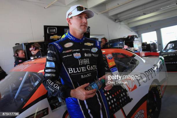 Daniel Hemric driver of the Poppy Bank Chevrolet stands in the garage area during practice for the NASCAR XFINITY Series Championship Ford EcoBoost...