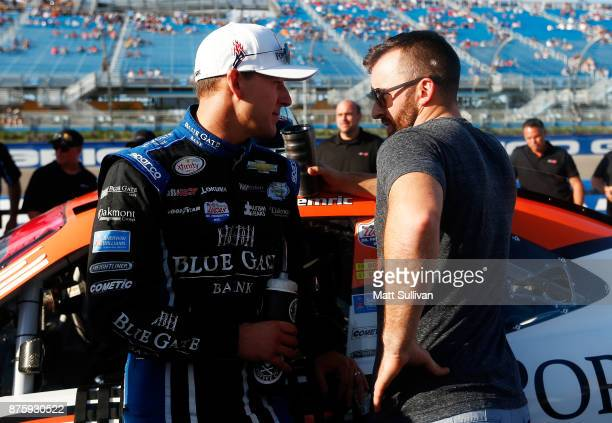 Daniel Hemric driver of the Poppy Bank Chevrolet talks to Austin Dillon driver of the DOW WeatherTech Chevrolet during prerace ceremonies for the...