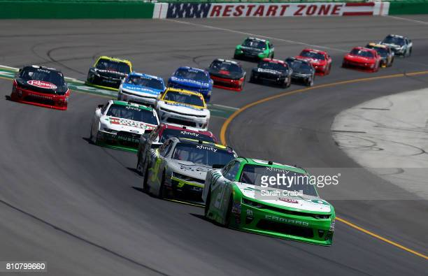 Daniel Hemric driver of the Red Kap/Alsco Chevrolet leads a pack of cars during the NASCAR XFINITY Series Alsco 300 at Kentucky Speedway on July 8...