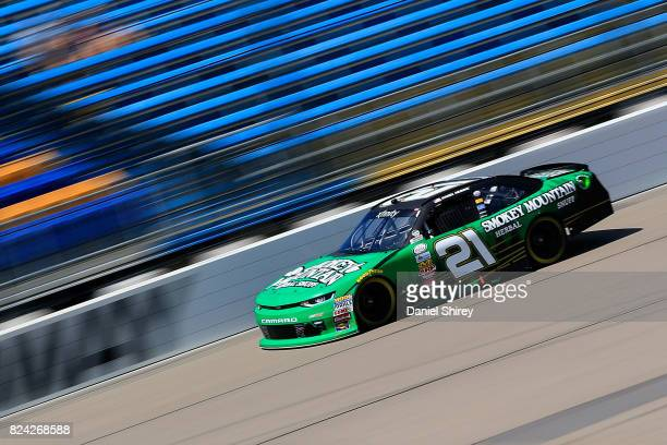 Daniel Hemric driver of the Smokey Mountain Herbal Snuff Chevrolet races during qualifying for the NASCAR XFINITY Series US Cellular 250 Presented by...
