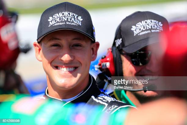 Daniel Hemric driver of the Smokey Mountain Herbal Snuff Chevrolet stands on the grid during qualifying for the NASCAR XFINITY Series US Cellular 250...