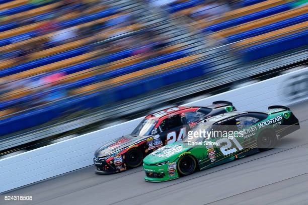 Daniel Hemric driver of the Smokey Mountain Herbal Snuff Chevrolet races Dylan Lupton driver of the Nut Up Toyota during the NASCAR XFINITY Series US...