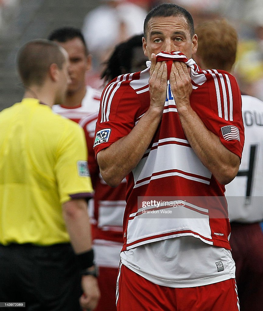 <a gi-track='captionPersonalityLinkClicked' href=/galleries/search?phrase=Daniel+Hernandez&family=editorial&specificpeople=2157363 ng-click='$event.stopPropagation()'>Daniel Hernandez</a> #2 of the FC Dallas reacts as he leaves the field after being shown the red card during the first half of a soccer game against the Colorado Rapids at FC Dallas Stadium on May 6, 2012 in Frisco, Texas.