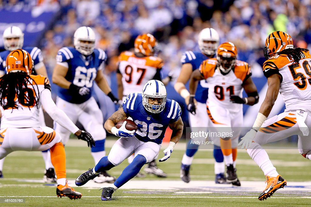 Daniel Herron #36 of the Indianapolis Colts runs with the ball against the Cincinnati Bengals in the second half during their AFC Wild Card game at Lucas Oil Stadium on January 4, 2015 in Indianapolis, Indiana.