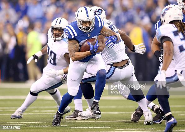 Daniel Herron of the Indianapolis Colts runs with the ball against the Tennessee Titans at Lucas Oil Stadium on January 3 2016 in Indianapolis Indiana