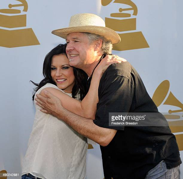 Daniel Hill hugs Martina McBride at the GRAMMY Block Party at Owen Bradley Park on May 13 2014 in Nashville Tennessee