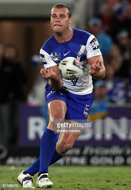 Daniel Holdsworth of the Bulldogs passes the ball during the round 10 NRL match between the Gold Coast Titans and the Canterbury Bulldogs at Skilled...