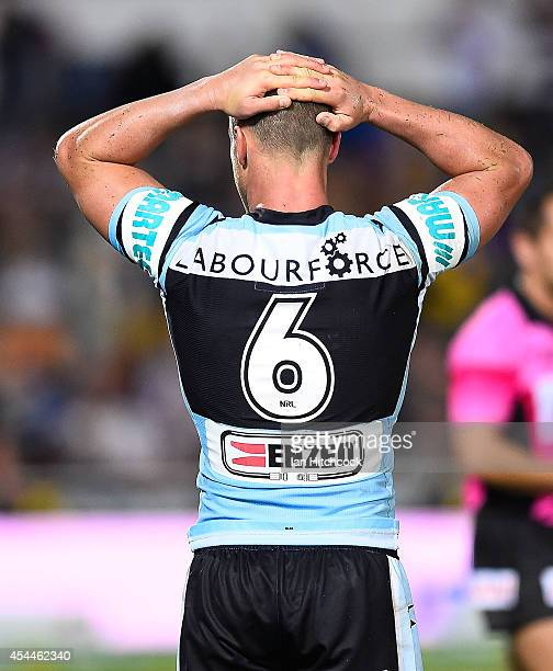 Daniel Holdsworth of the Sharks looks dejected after losing the round 25 NRL match between the North Queensland Cowboys and the Cronulla Sharks at...