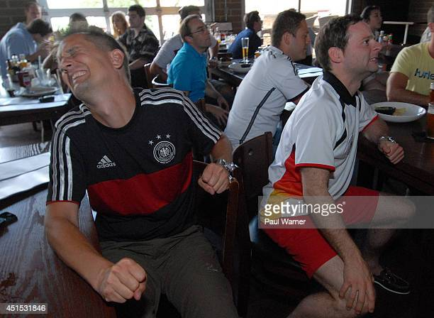 Daniel Hradetzky originally of Stuttgart Germany and Daniel Muecke orginally of Duesseldorf Germany watch the Germany vs Algeria World Cup match at...