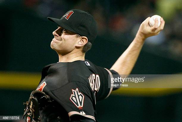 Daniel Hudson of the Arizona Diamondbacks delivers a pitch against the San Diego Padres during the sixth inning of a MLB game at Chase Field on...