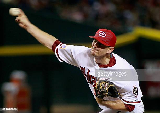 Daniel Hudson of the Arizona Diamondbacks delivers a pitch against the Colorado Rockies during the eighth inning of a MLB game at Chase Field on July...