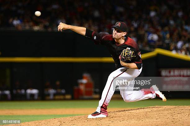 Daniel Hudson of the Arizona Diamondbacks delivers a pitch during the ninth inning against the San Francisco Giants at Chase Field on May 14 2016 in...