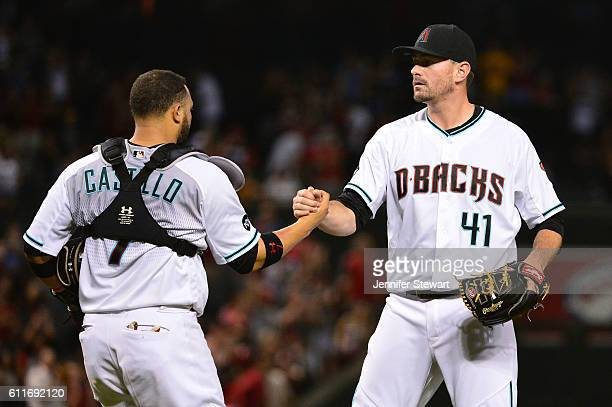 Daniel Hudson of the Arizona Diamondbacks is congratulated by Welington Castillo after closing out the game against the San Diego Padres at Chase...