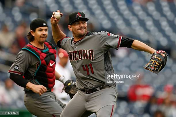 Daniel Hudson of the Arizona Diamondbacks makes a throw to first base for the third out of the eighth inning against the Washington Nationals at...