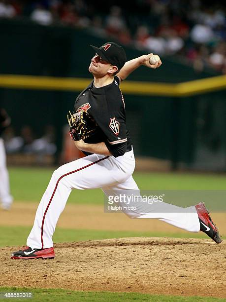Daniel Hudson of the Arizona Diamondbacks throws against the Los Angeles Dodgers during the ninth inning of a MLB game at Chase Field on September 12...