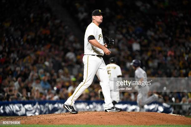 Daniel Hudson of the Pittsburgh Pirates reacts as Dusty Coleman of the San Diego Padres rounds the bases after hitting a two run home run in the...