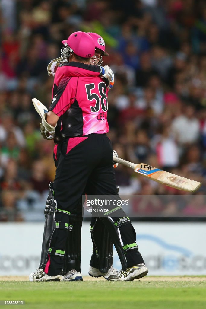 Daniel Hughes and <a gi-track='captionPersonalityLinkClicked' href=/galleries/search?phrase=Brett+Lee&family=editorial&specificpeople=169885 ng-click='$event.stopPropagation()'>Brett Lee</a> of the Sixers celebrate victory during the Big Bash League match between Sydney Thunder and the Sydney Sixers at ANZ Stadium on December 30, 2012 in Sydney, Australia.
