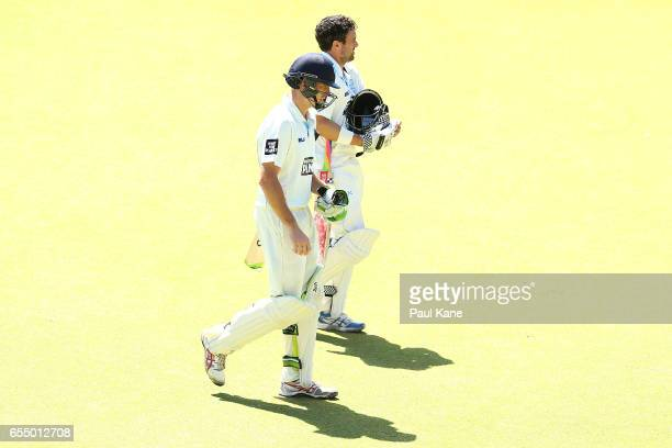 Daniel Hughes and Ed Cowan of New South Wales walk from the ground at the lunch break during the Sheffield Shield match between Western Australia and...