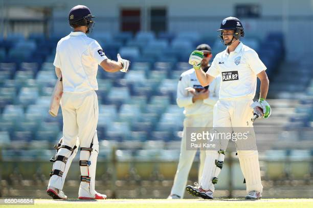 Daniel Hughes of New South Wales celebrates his century during the Sheffield Shield match between Western Australia and New South Wales at WACA on...