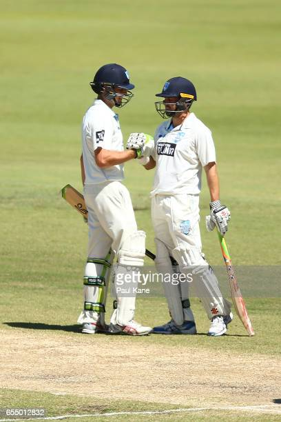 Daniel Hughes of New South Wales celebrates his half century with Ed Cowan during the Sheffield Shield match between Western Australia and New South...