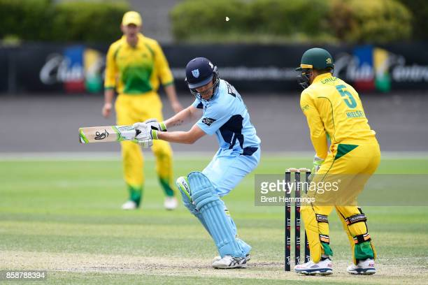 Daniel Hughes of NSW is caught behind by Harry Nielsen of CAXI during the JLT One Day Cup match between New South Wales and the Cricket Australia XI...