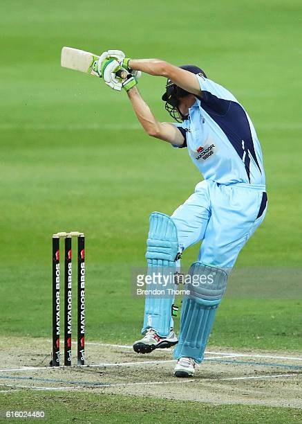 Daniel Hughes of the Blues is struck on the helmet by a short delivery during the Matador BBQs One Day Cup match between New South Wales and Victoria...