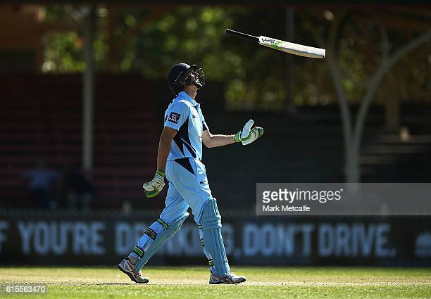 Daniel Hughes of the Blues tosses his bat after being dismissed short of a century during the Matador BBQs One Day Cup match between New South Wales...
