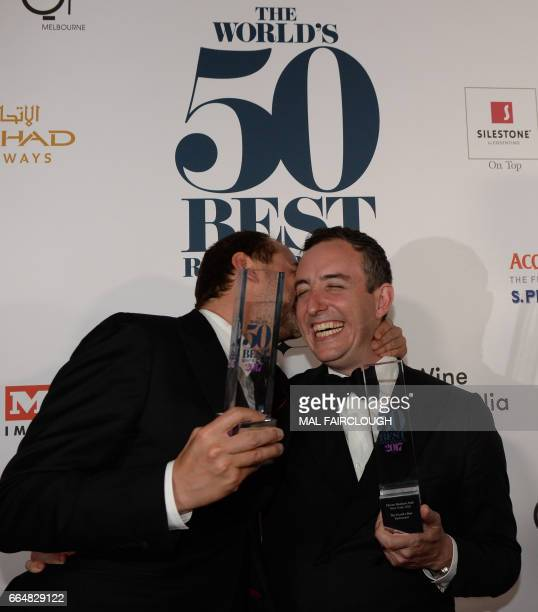 Daniel Humm and Will Guidara celebrate with their trophies after winning the Worlds Best Restaurant award at the World's 50 Best Restaurants awards...