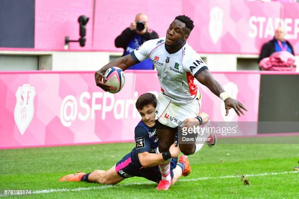 Daniel Ikpefan of Oyonnax is tackled by Arthur Coville of Stade Français Paris during the Top 14 match between Stade Francais and Oyonnax on November...