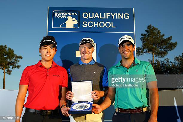 Daniel Im of the USA Ulrich Van den Berg of South Africa and Adrian Otaegui of Spain pose with the winners trophy after all finishing jointly on 18...
