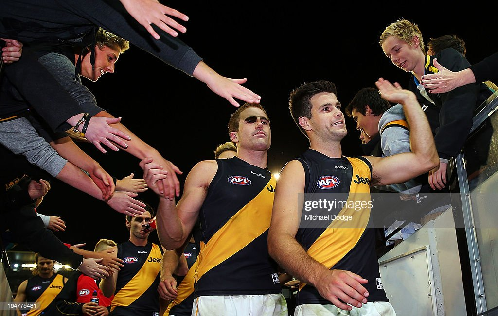 A Daniel Jackson (L) and Trent Cotchin of the Tigers celebrate the win with supporters during the round one AFL match between the Carlton Blues and the Richmond Tigers at Melbourne Cricket Ground on March 28, 2013 in Melbourne, Australia.