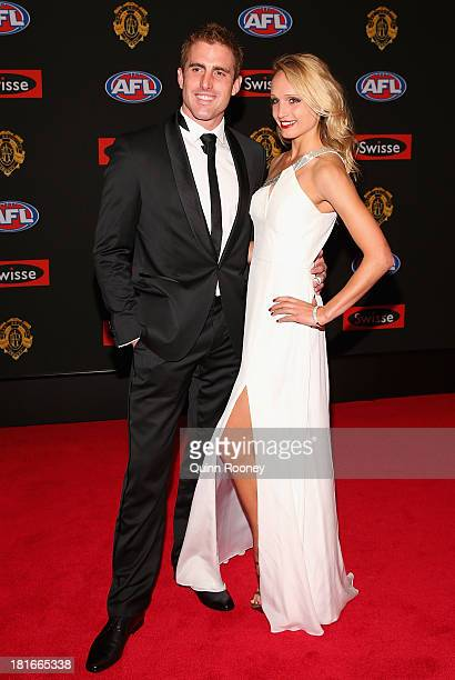 Daniel Jackson of the Tigers and partner Chrissy Kingma arrive ahead of the 2013 Brownlow Medal at Crown Palladium on September 23 2013 in Melbourne...