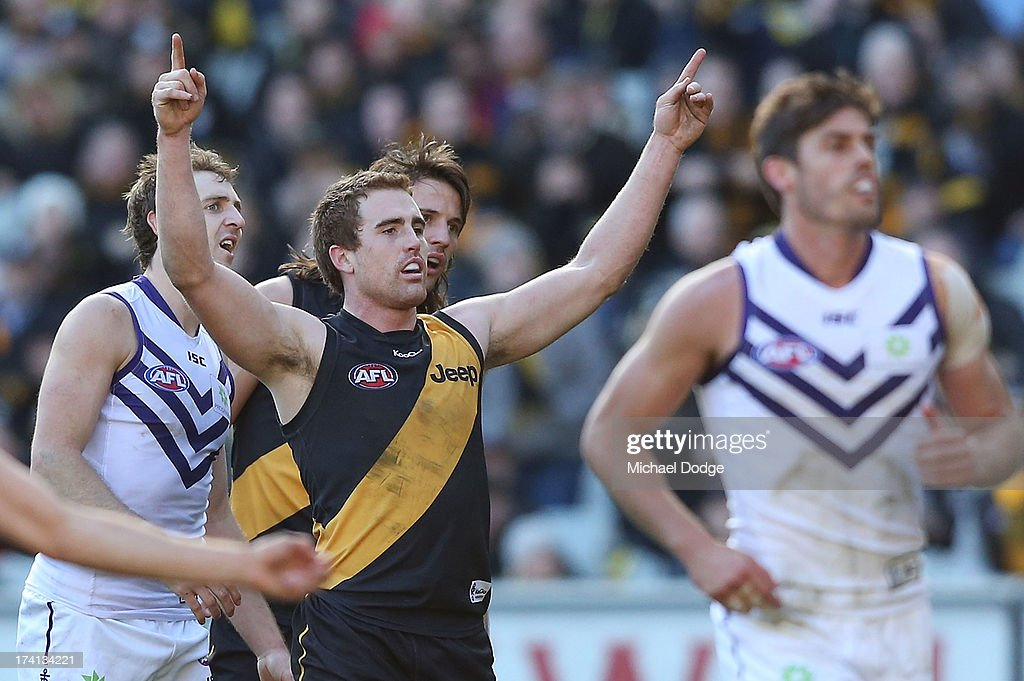 Daniel Jackson of the Tigers celebrates a goal in front of Michael Barlow of the Dockers during the round 17 AFL match between the Richmond Tigers and the Fremantle Dockers at Melbourne Cricket Ground on July 21, 2013 in Melbourne, Australia.