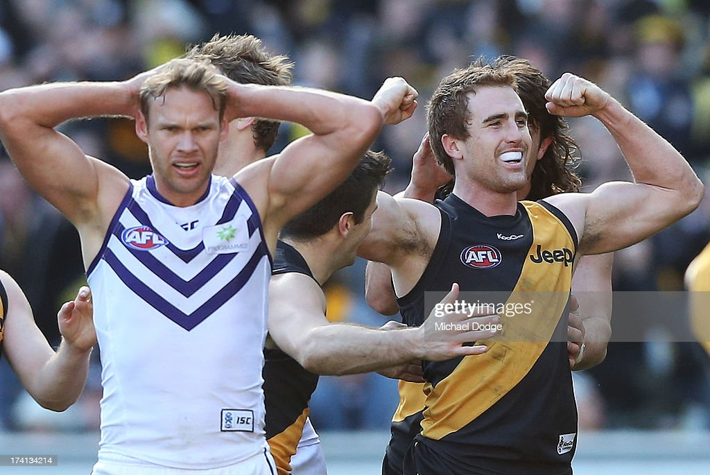 Daniel Jackson of the Tigers celebrates a goal next to Paul Duffield of the Dockers during the round 17 AFL match between the Richmond Tigers and the Fremantle Dockers at Melbourne Cricket Ground on July 21, 2013 in Melbourne, Australia.