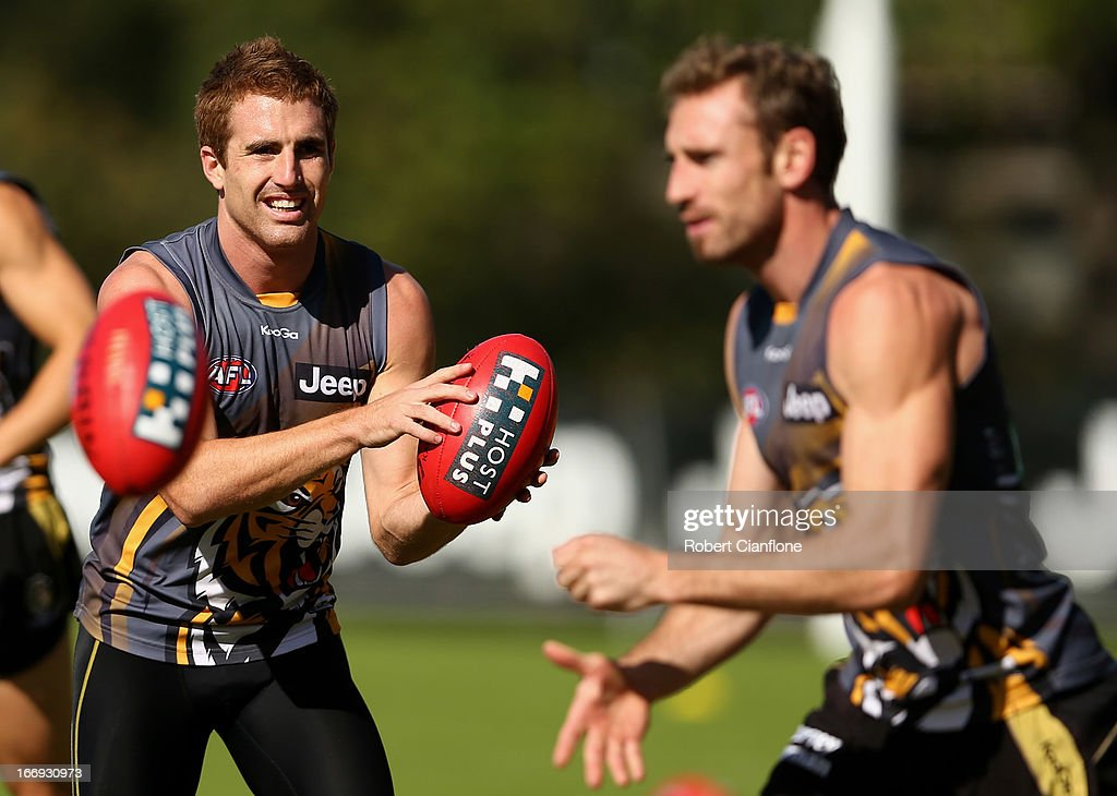 Daniel Jackson of the Tigers handballs during a Richmond Tigers AFL training session at ME Bank Centre on April 19, 2013 in Melbourne, Australia.