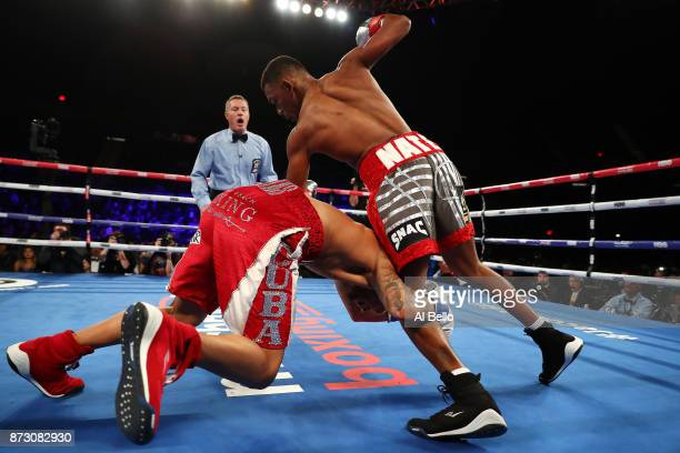 Daniel Jacobs and Luis Arias tumble to the mat as Arias grabs Jacobs leg in the first round during their Middleweight bout at Nassau Veterans...