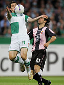 Daniel Jarque of Espanyol and Miroslav Klose of Bremen fight for the ball during the UEFA Cup semifinal 2nd leg match between Werder Bremen and...