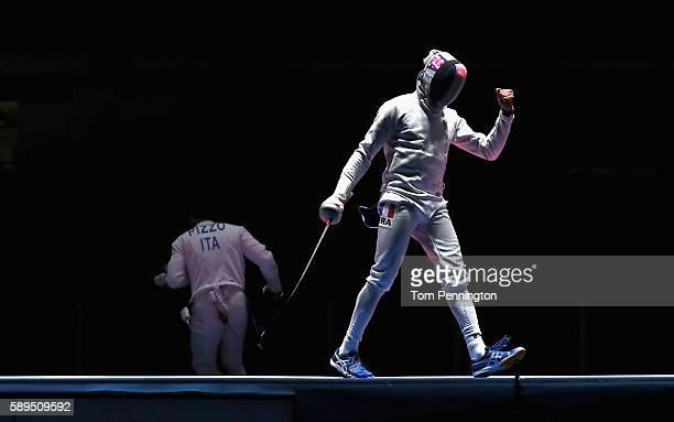 Daniel Jerent of France react against Paolo Pizzo of Italy during the Men's Epee Team Gold Medal Match on Day 9 of the Rio 2016 Olympic Games at the...