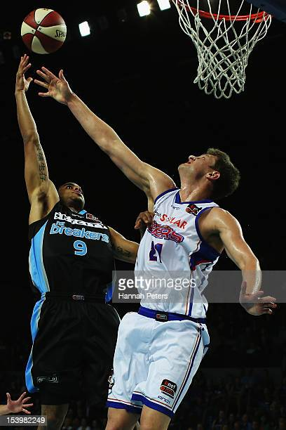 Daniel Johnson of Adelaide defends against Corey Webster of the Breakers during the round two NBL match between the New Zealand Breakers and the...