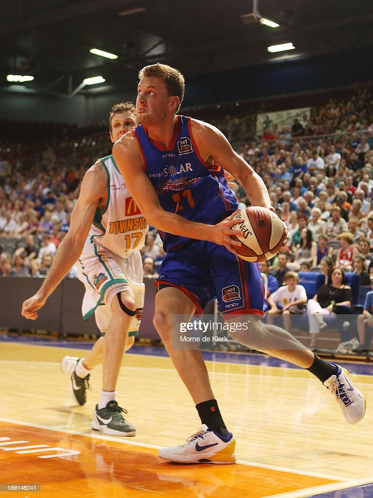 Daniel Johnson of Adelaide goes for the basket during the round 13 NBL match between the Adelaide 36ers and the Townsville Crocodiles at Adelaide Arena on January 4, 2013 in Adelaide, Australia.