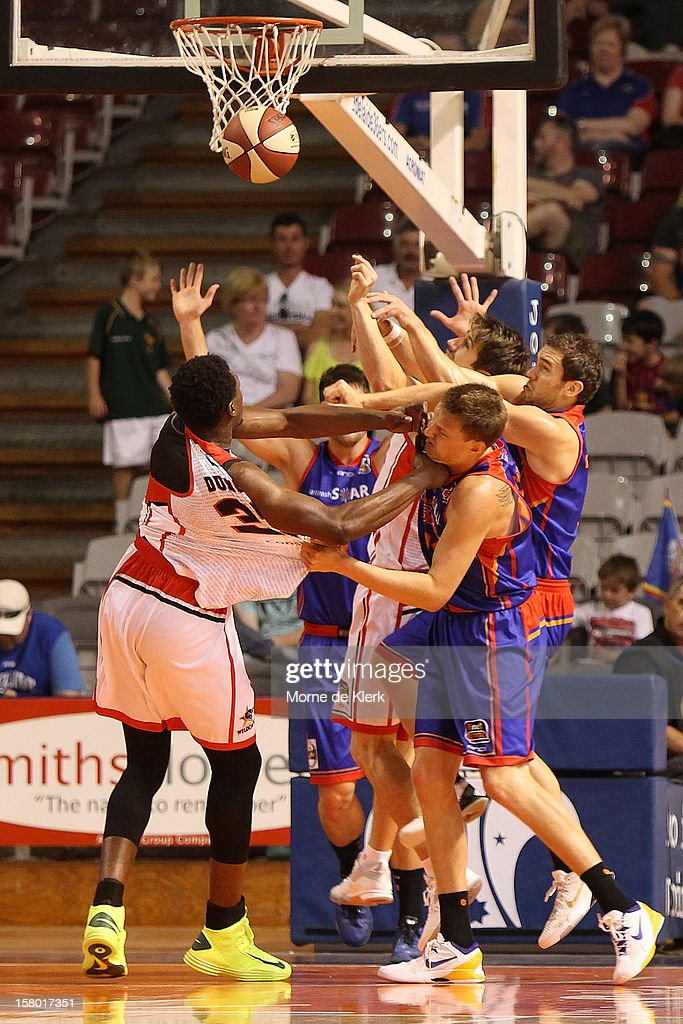 Daniel Johnson of Adelaide tries to stop Michael Dunigan of Perth from scoring during the round ten NBL match between the Adelaide 36ers and the Perth Wildcats at Adelaide Arena on December 9, 2012 in Adelaide, Australia.