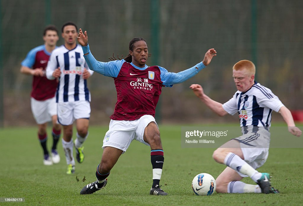 <a gi-track='captionPersonalityLinkClicked' href=/galleries/search?phrase=Daniel+Johnson+-+Soccer+Player&family=editorial&specificpeople=14584644 ng-click='$event.stopPropagation()'>Daniel Johnson</a> of Aston Villa is challenged by Liam O'Neil of West Bromwich Albion during the Barclays Premier Reserve League match between Aston Villa Reserves and West Bromwich Albion Reserves at the club's training ground at Bodymoor Heath on February 21, 2012 in Birmingham, England.