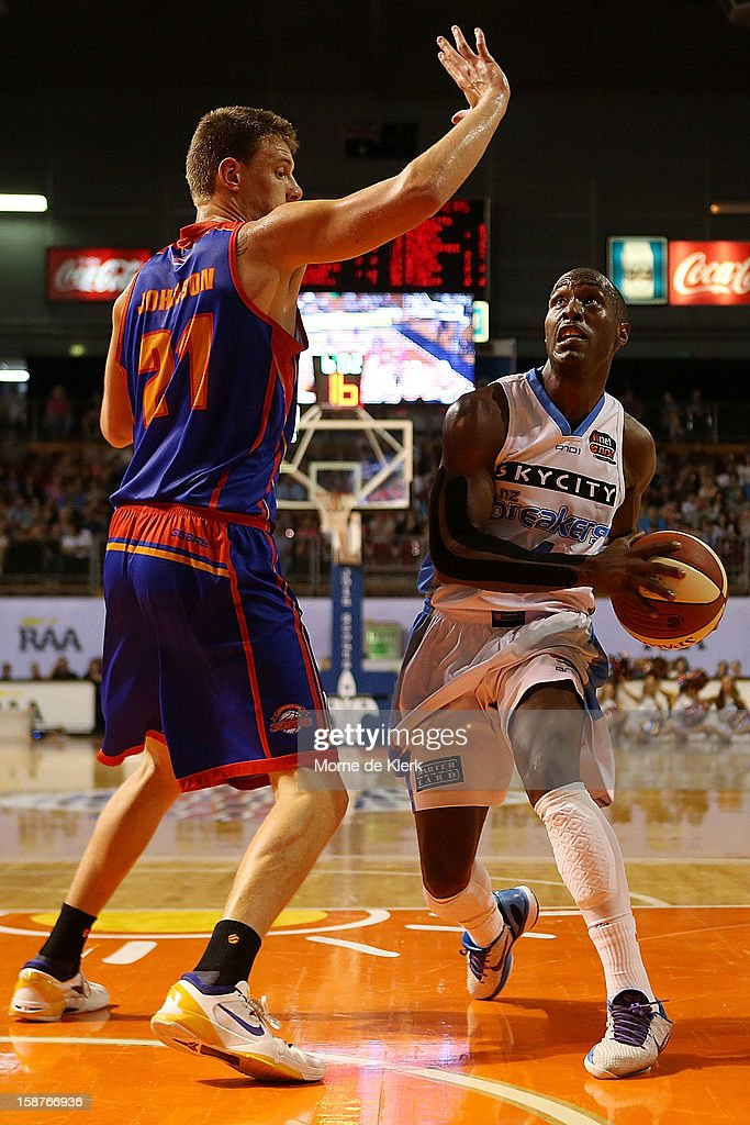 Daniel Johnson of the 36ers blocks Cedric Jackson of the Breakers during the round 12 NBL match between the Adelaide 36ers and the New Zealand Breakers at Adelaide Arena on December 28, 2012 in Adelaide, Australia.