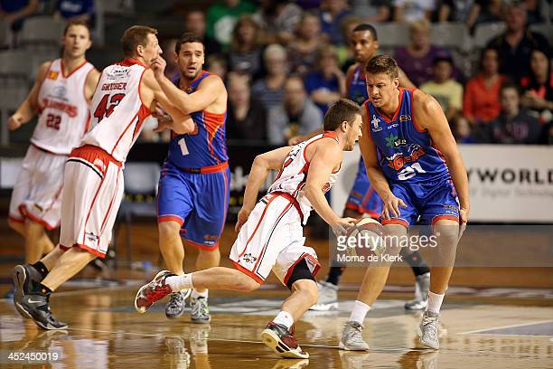 Daniel Johnson of the 36ers defends during the round eight NBL match between the Adelaide 36ers and the Wollongong Hawks at Adelaide Arena in...