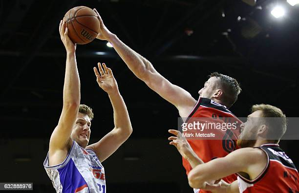 Daniel Johnson of the 36ers has a shot blocked by Andrew Ogilvy of the Hawks during the round 17 NBL match between the Illawarra Hawks and the...