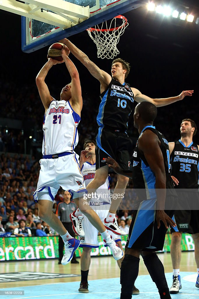 Daniel Johnson of the 36ers lays up the ball under pressure from Tom Abercrombie of the Breakers during the round 21 NBL match between the New Zealand Breakers and the Adelaide 36ers at Vector Arena on February 28, 2013 in Auckland, New Zealand.