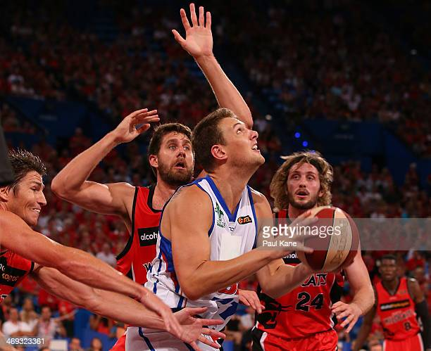 Daniel Johnson of the 36ers looks to shoot against Tom Jervis of the Wildcats during the round 18 NBL match between the Perth Wildcats and the...