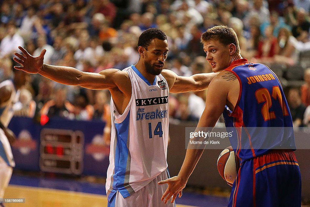 Daniel Johnson of the 36ers reacts as Mika Vukona of the Breakers defends during the round 12 NBL match between the Adelaide 36ers and the New Zealand Breakers at Adelaide Arena on December 28, 2012 in Adelaide, Australia.