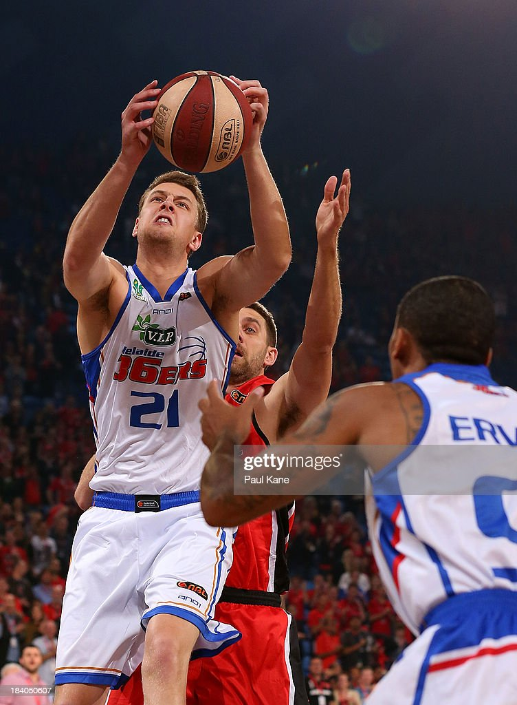 Daniel Johnson of the 36ers rebounds during the round one NBL match between the Perth Wildcats and the Adelaide 36ers at Perth Arena in October 11, 2013 in Perth, Australia.
